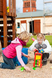 Girls playing on the playground having fun Stock Photography