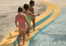 Girls playing at pool. Follow the yellow brick road Stock Photography