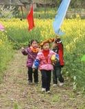 Girls playing in the rape field ,chengdu,china Stock Photo