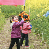 Girls playing in the rape field ,chengdu,china Royalty Free Stock Photo