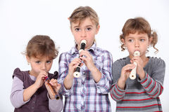 Girls playing the recorder Stock Photography