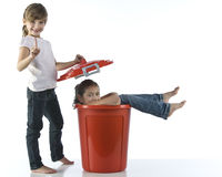 Girls playing with red bin Royalty Free Stock Photos