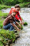 Girls playing by river stock photos