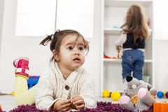 Girls playing in the room Stock Photos