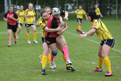Girls playing rugby Stock Images