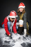 Girls Playing with Snow Royalty Free Stock Photos