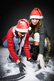 Girls Playing with Snow Royalty Free Stock Photo
