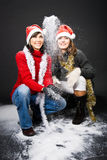 Girls Playing with Snow Stock Images
