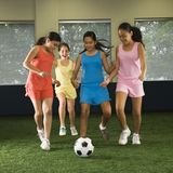 Girls playing soccer. Stock Images