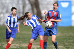 Girls playing soccer. Female soccer or football players pictured in action during the game between Fair-Play Bucharest and FCM Targu-Mures, Romanian Women First Stock Images