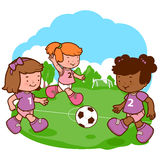 Girls playing soccer Stock Photos
