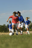 Girls Playing Soccer Stock Photography
