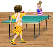 2 girls playing table tennis. 2 girls or young teens playing a table tennis match. The table standing on a wood floor. The scene could be indoors or outdoors Stock Photo