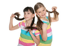 Girls playing with their tails Stock Photos
