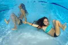 Girls Playing Underwater Royalty Free Stock Image