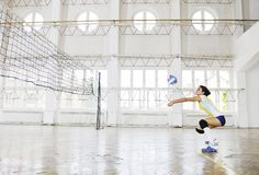 Girls playing volleyball indoor game Royalty Free Stock Images
