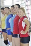 Girls playing volleyball indoor game Stock Image