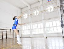 Girls playing volleyball indoor game Royalty Free Stock Image
