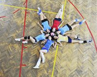 Girls playing volleyball indoor game Stock Photo