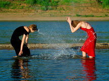 Girls playing with water Royalty Free Stock Image