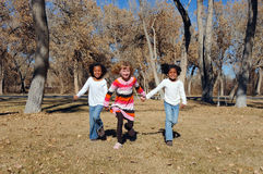 Girls playing on winter day. Little girls playing in woods on winter day Stock Images