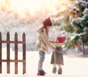 Girls playing on a winter walk Royalty Free Stock Image