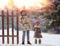 Girls playing on a winter walk Royalty Free Stock Photo