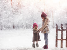 Girls playing on a winter walk Royalty Free Stock Photos