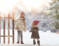 Girls playing on a winter walk Stock Images