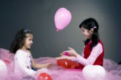 Girls Playing With Balloons Stock Image