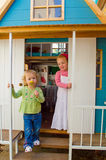 Girls playing in wooden house Stock Photography