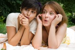 Girls pointing with finger on something Royalty Free Stock Photos