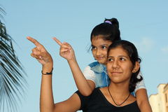 Girls pointing the fingers Royalty Free Stock Image