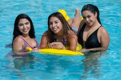 Girls At A Pool Party. Female friends at a pool party in the summer stock images