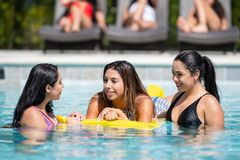 Girls At A Pool Party. Female friends at a pool party in the summer royalty free stock photo