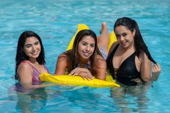 Girls At A Pool Party. Female friends at a pool party in the summer stock image