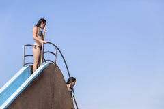 Girls Pool Slide Holidays Stock Photography