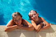 Girls in pool Royalty Free Stock Photo