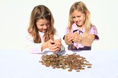 Girls pooring money thru hands. Smiling girls - kids pooring money thru hands - savings of czech crowns - small change Stock Photo