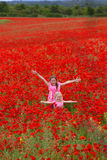 Girls with poppies Stock Images
