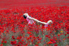 Girls with poppies. Young girls at the poppies field stock photo