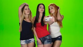 Girls pose for the camera of the smartphone. Green screen stock footage