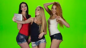 Girls pose for the camera of the tablet. Green screen stock video