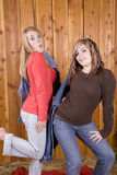 Girls posing in barn Royalty Free Stock Photos