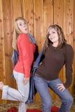Girls posing in barn Royalty Free Stock Photos