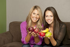 Girls Posing With Fruit Royalty Free Stock Photos