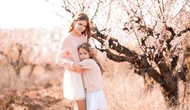 Girls posing in peach garden Royalty Free Stock Photo