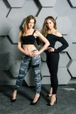 Girls posing portrait on a textured wall background royalty free stock photography
