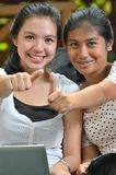 Girls posing thumbs Royalty Free Stock Photos