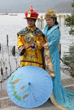 Girls posing in traditional Chinese costumes on the shores of West Lake in Hangzhou, China Stock Image